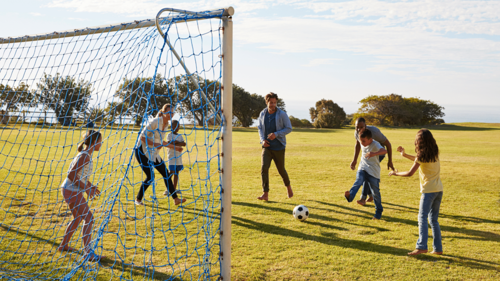 two families playing soccer together
