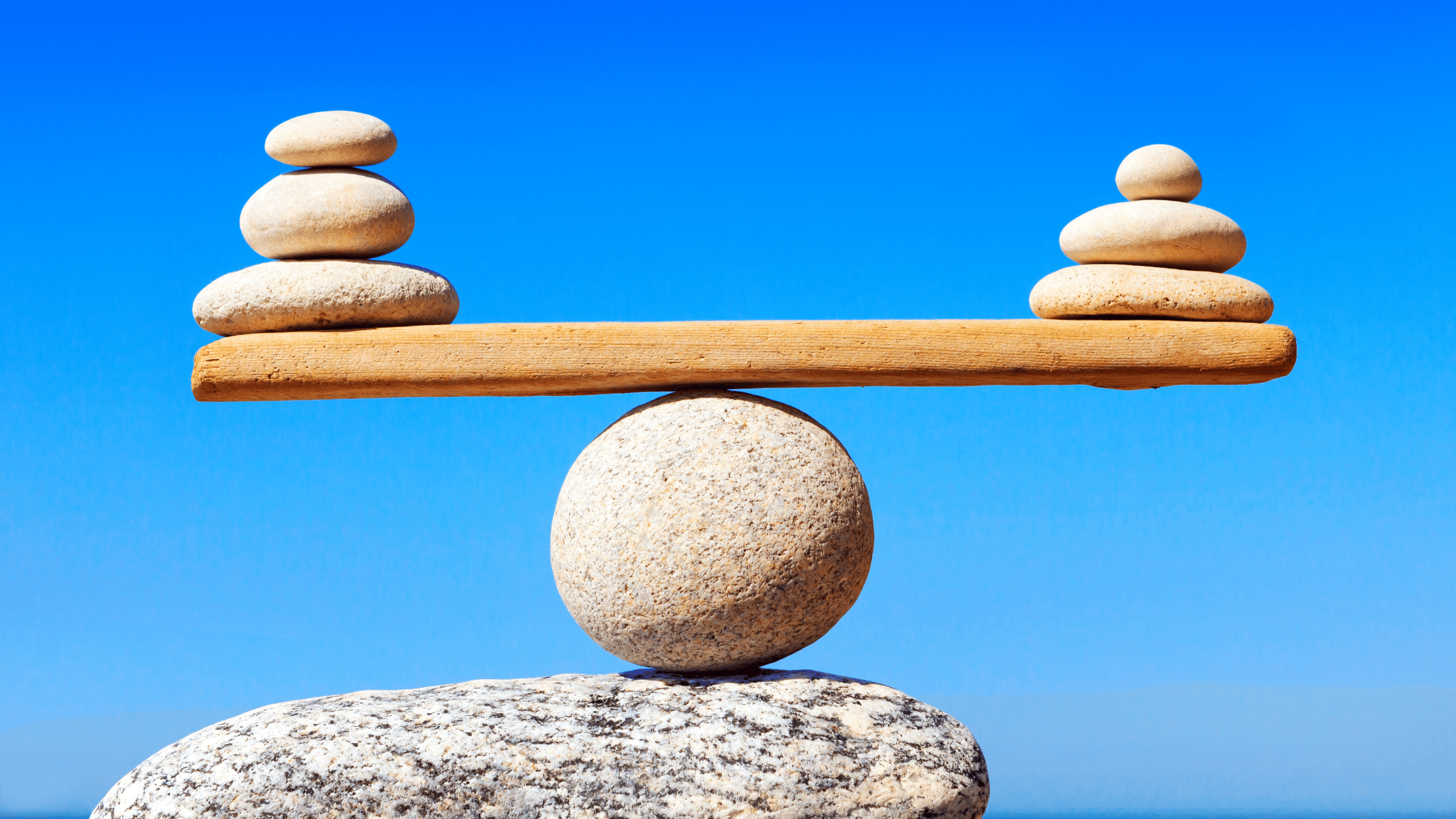 rocks balancing on a plank