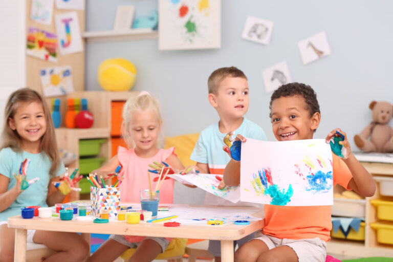 cute children painting in the pre-k classroom