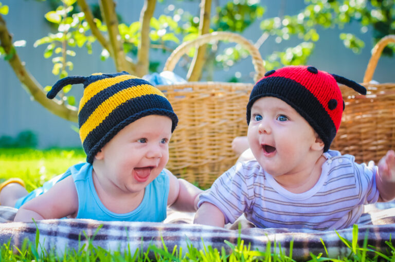 infant twins enjoying the summer at daycare