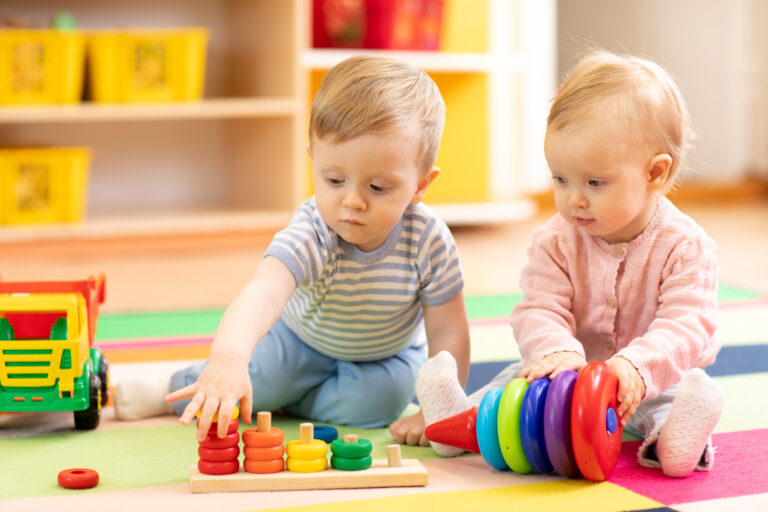 children playing on floor with educational toys at daycare