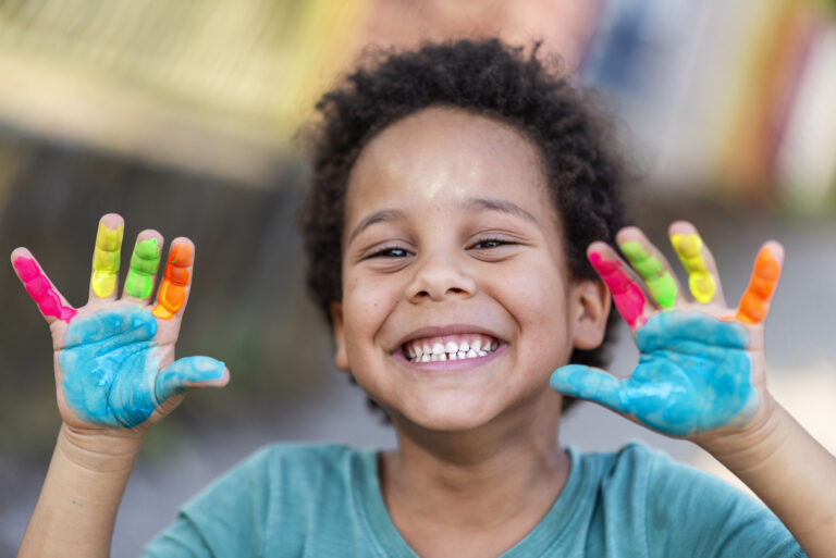 3 year old boy with painted hands