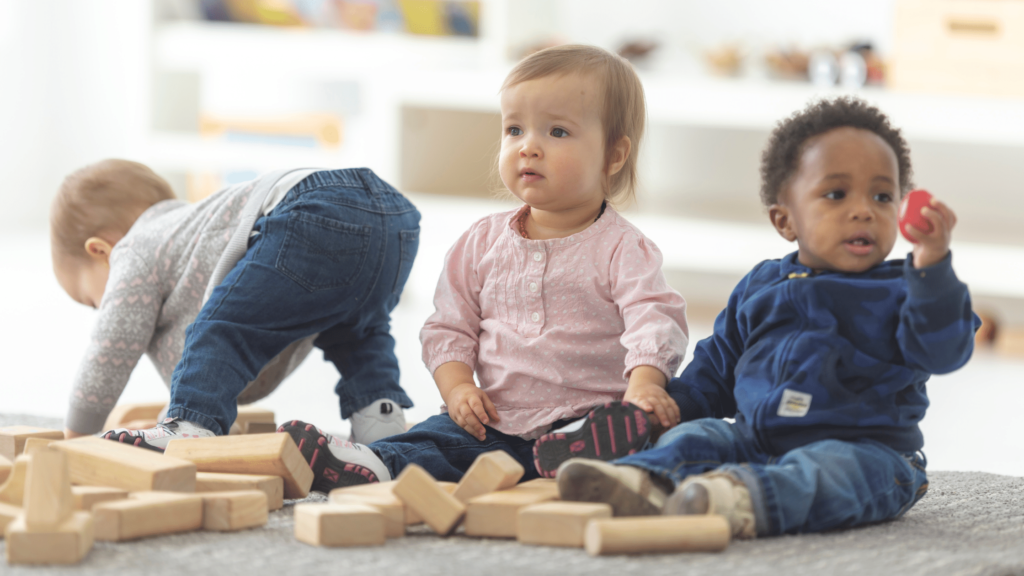 toddlers playing with wooden blocks and learning new things