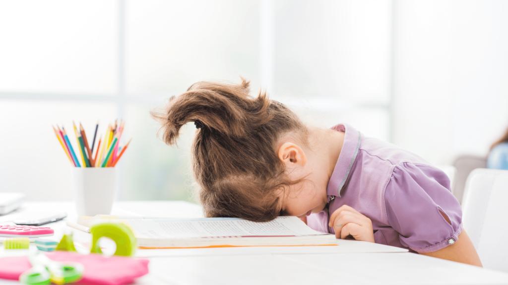 preschooler trying to focus on an assignment