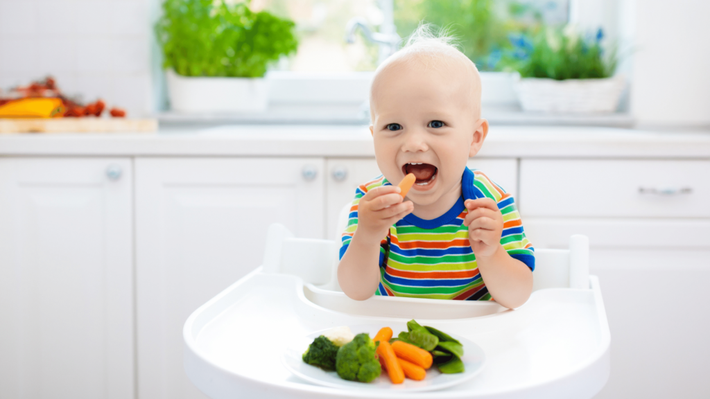 a young toddler eating healthy vegetables