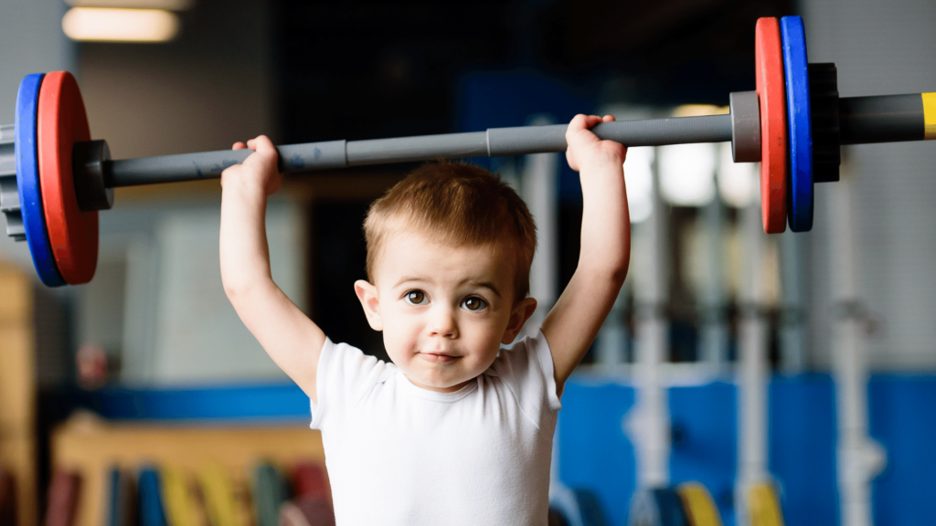 toddler lifting weights for fun